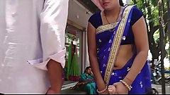 Desi Bhabhi exposing navel in blue saree