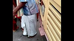 tamil oldman touching school girls with his stick at busstand