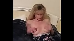Sexy blonde milf on bed