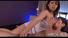 Oriental milf gets partial shaved cunt hammered from behind