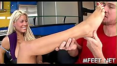 Nasty and agile brunette hair performs footjob experiments for her stud